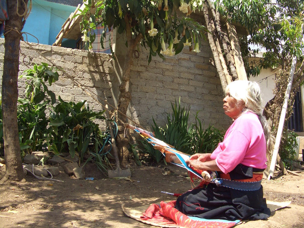 Triqui women weaving the traditional whepeel