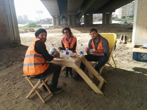 Lunch break during construction time, using our first constructed bench