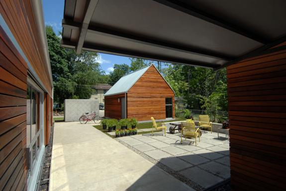 Three gable forms create a south facing courtyard that is the focal point of the design as nearly every room opens to it through full height windows
