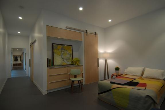 The master bedroom suite also includes built in cabinetry as well as a walk-in closet
