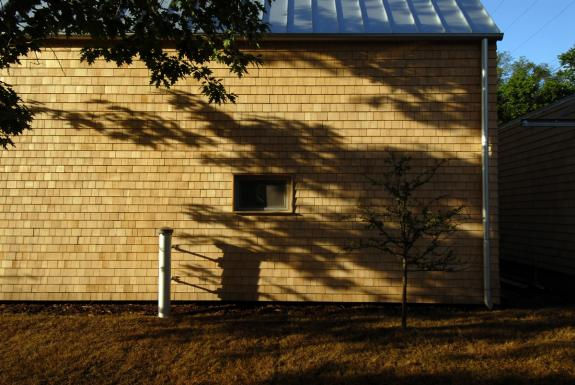 The rich quality of the Alaskan yellow cedar shingles guided the exterior language