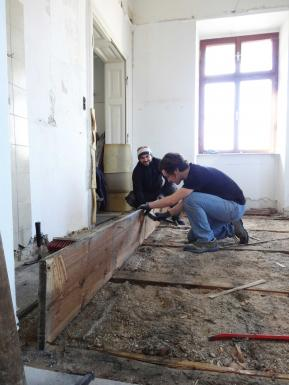 removing the old wooden floor for the new electricty and water pipes