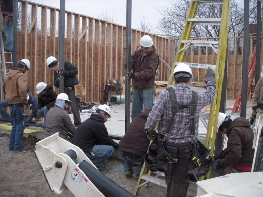 The students work on the steel structural frame