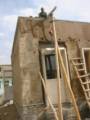 Plastering, artificial stone frames around door and windows