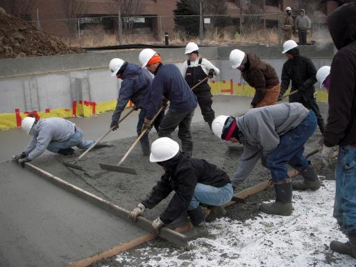 The students pour the basement slab